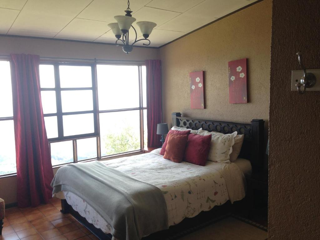 A bed or beds in a room at Poas Lodge