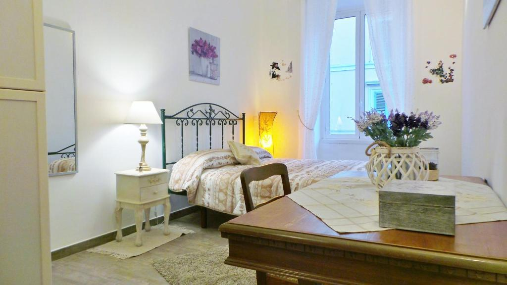 A bed or beds in a room at Cuore di Testaccio Apartment