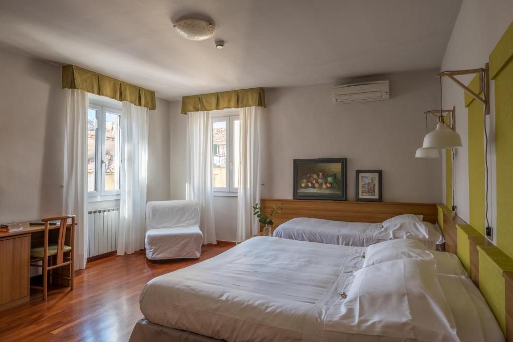 Cama ou camas em um quarto em Hotel Colomba