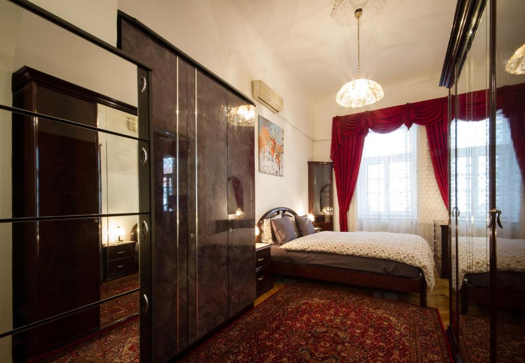 Posteľ alebo postele v izbe v ubytovaní Historical Center Apartment