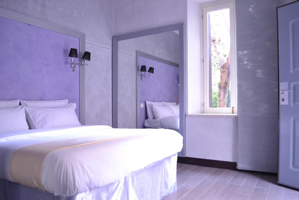 A bed or beds in a room at Tiburtina House