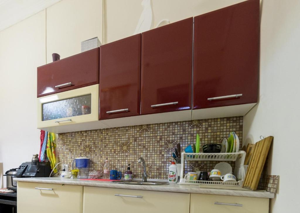 A kitchen or kitchenette at Hostel Tsentral