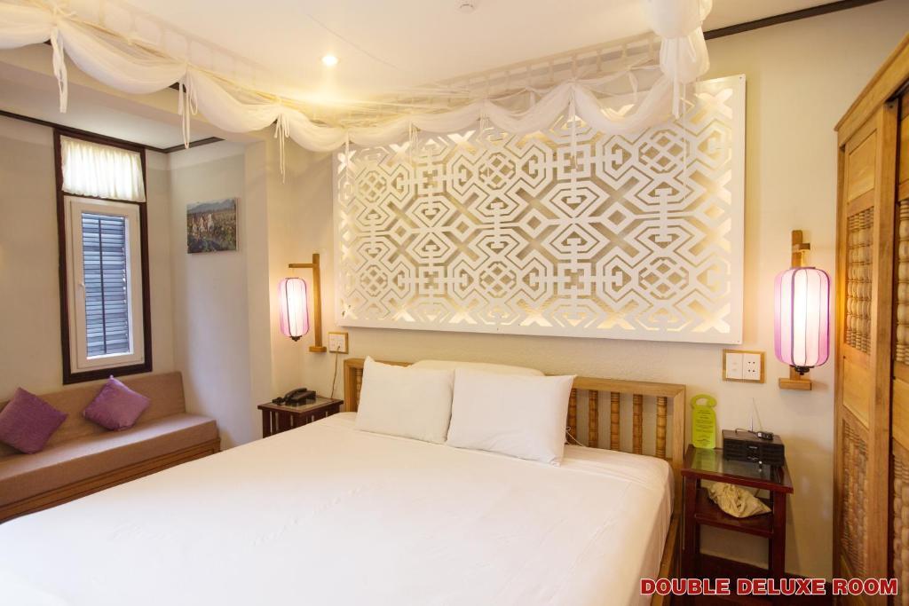Phòng Deluxe Giường Đôi/2 Giường Đơn Có Cửa Sổ Và Ban Công
