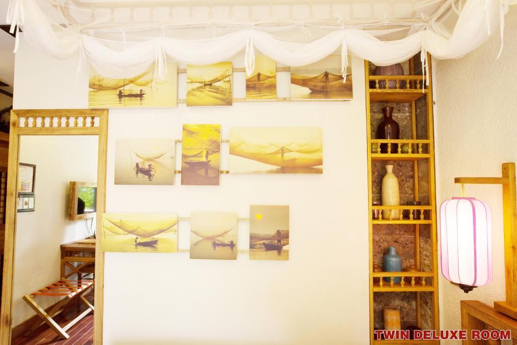 Phòng Deluxe Gia Đình Có Cửa Sổ Và Ban Công