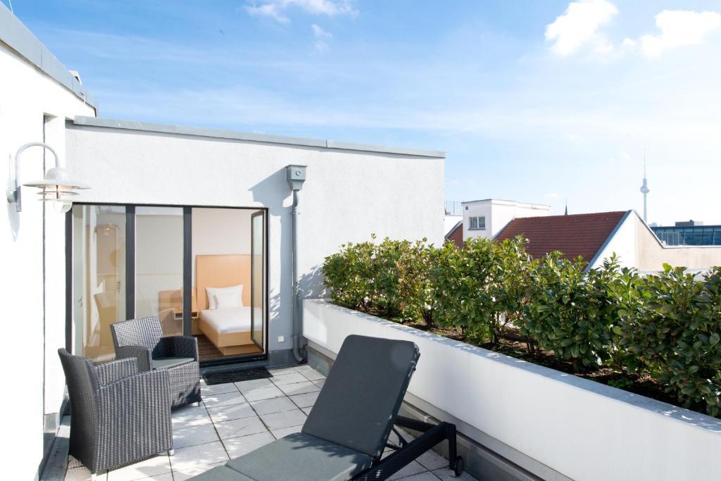 Балкон или терраса в HSH Hotel Apartments Mitte