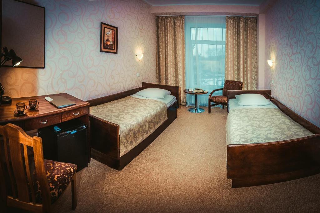 Кровать или кровати в номере Отель Интурист