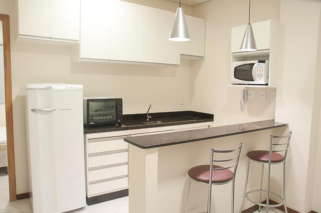 A kitchen or kitchenette at Flats Unicaflex
