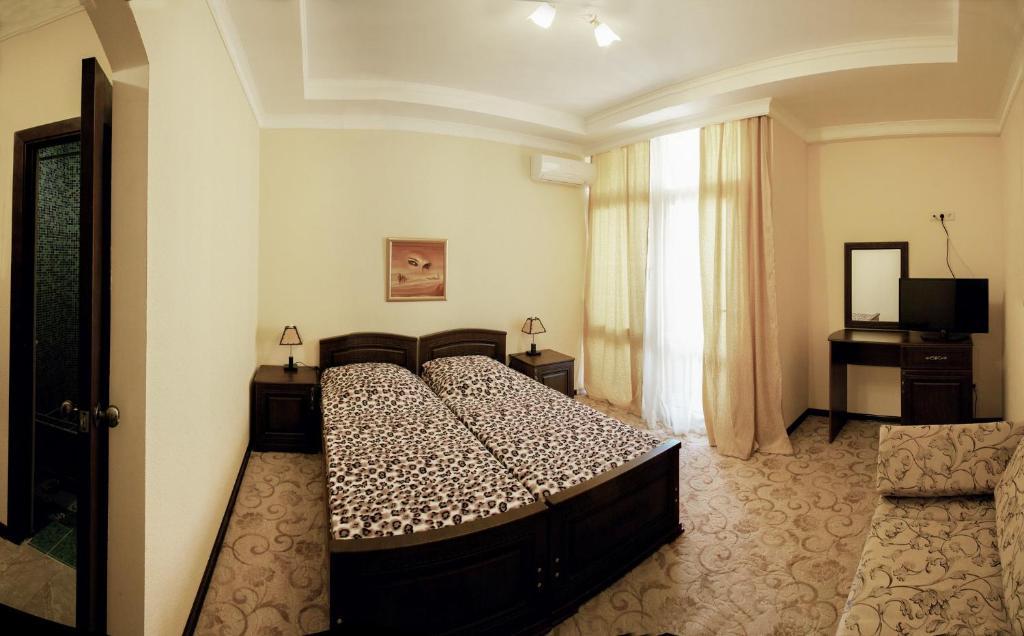 Кровать или кровати в номере Гостевой дом Рафаэль
