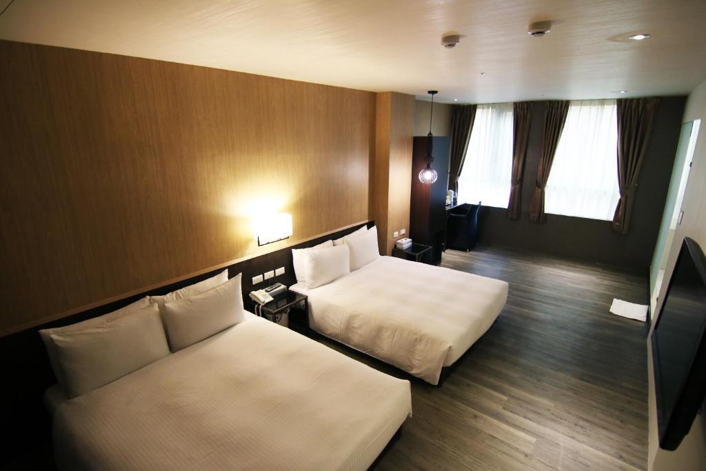 เตียงในห้องที่ Diary of Ximen Hotel - Liufu Branch