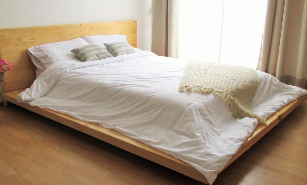 Cama o camas de una habitación en Cedar Cats Apartments