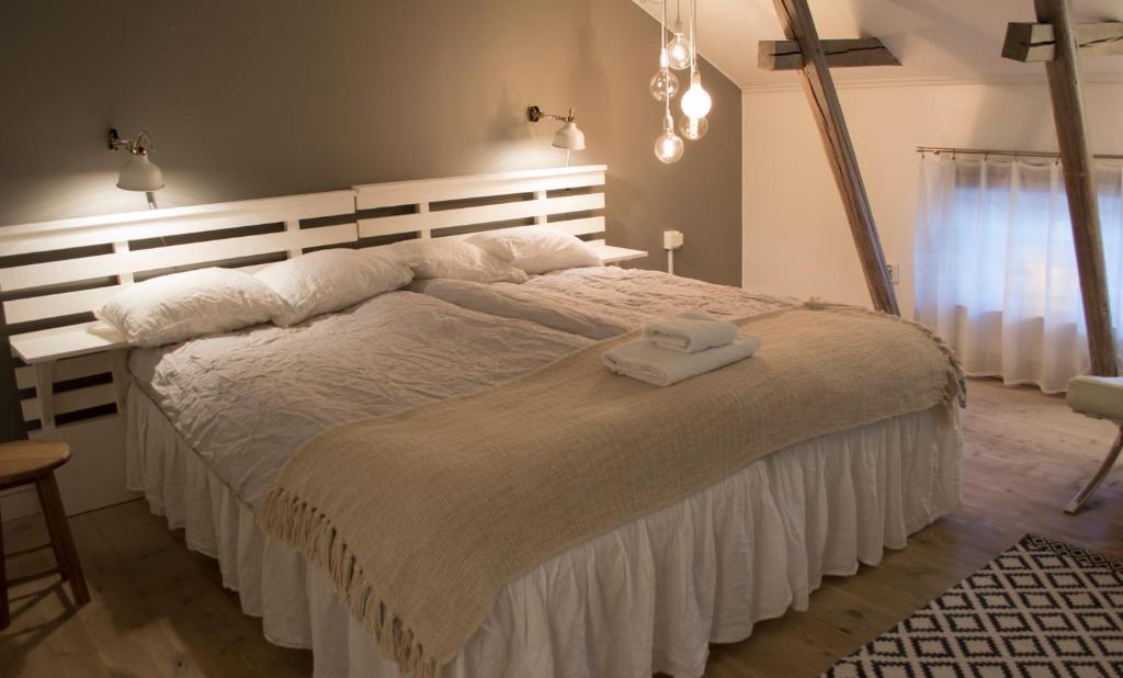 A bed or beds in a room at Af Klara