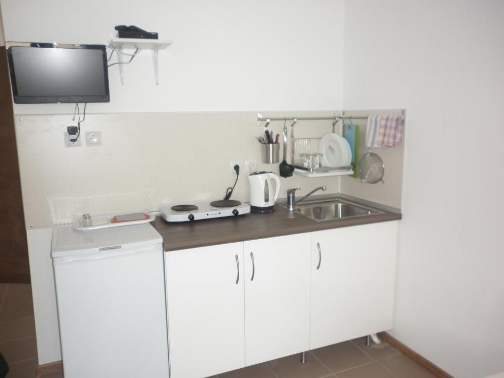 Кухня или мини-кухня в Дом на Лесной
