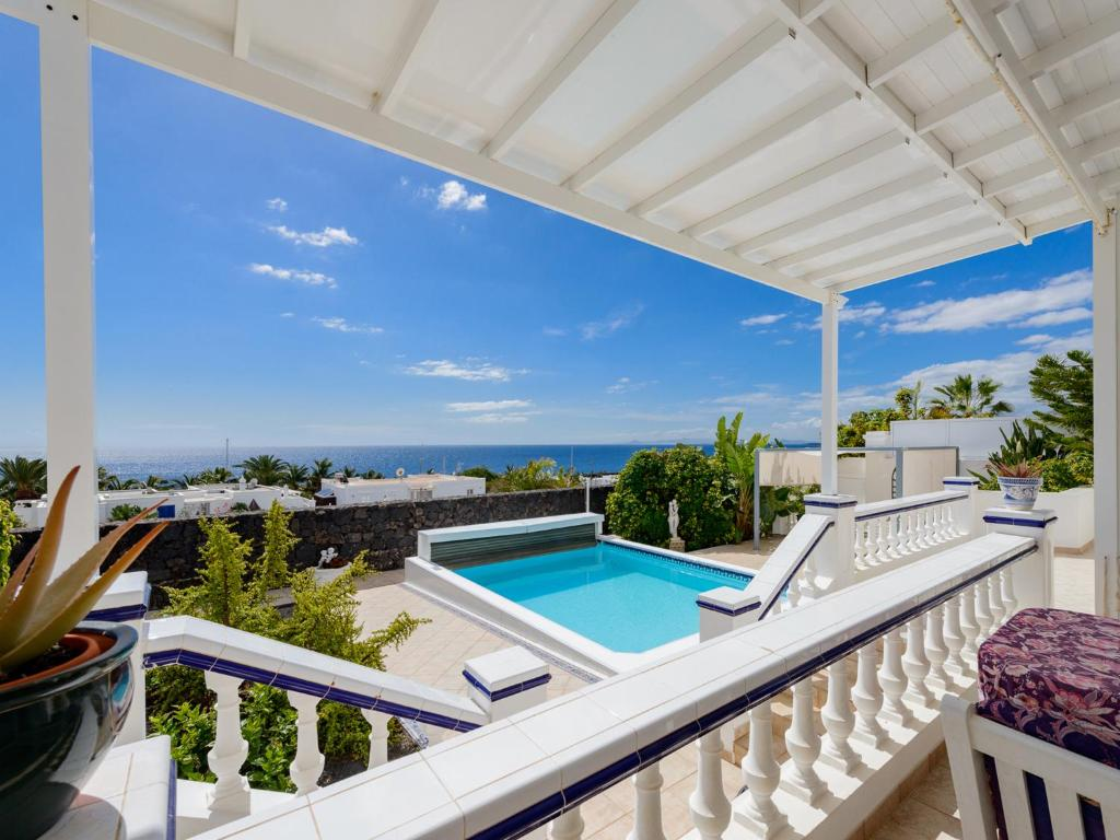 A view of the pool at Villa Fortuna or nearby