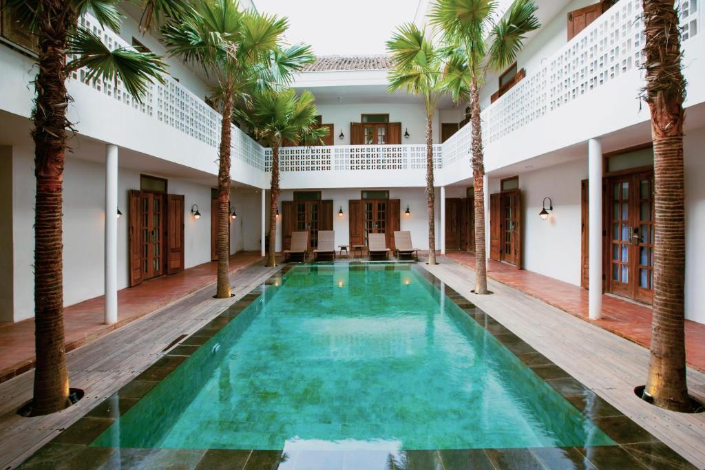 The swimming pool at or near Adhisthana Hotel Yogyakarta
