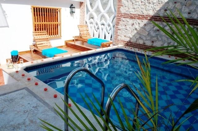 The swimming pool at or near Hotel Boutique Las Carretas