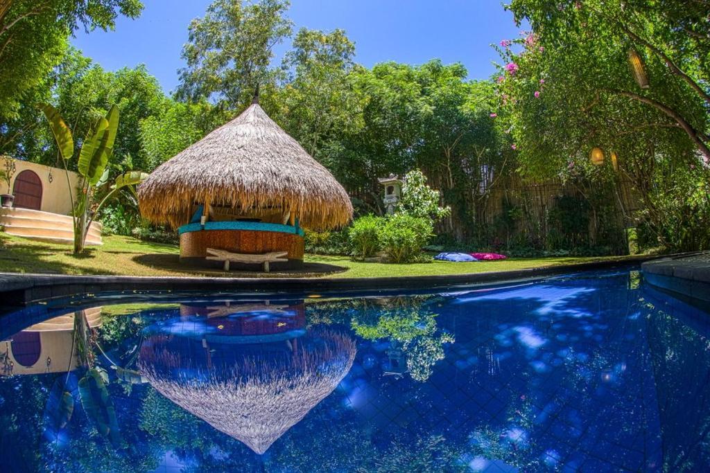 The swimming pool at or near Uluwatu Beach House
