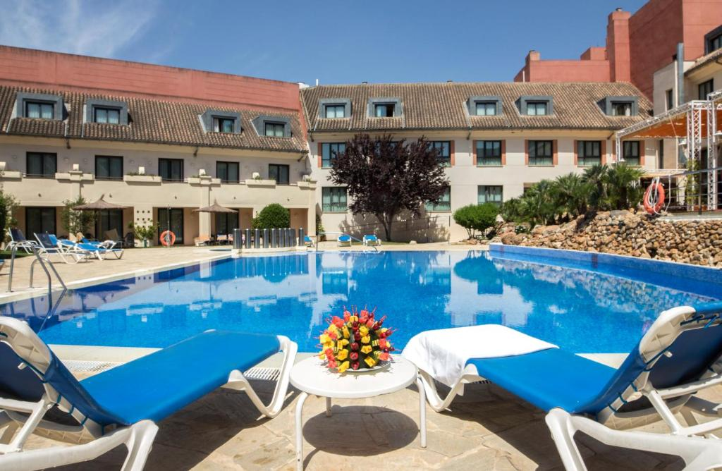 The swimming pool at or near Hotel Antequera by Checkin