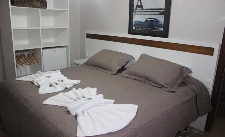 A bed or beds in a room at Pousada dos Pássaros Gramado
