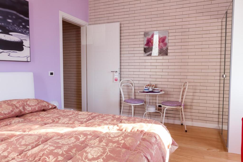 Letto o letti in una camera di Bevilacqua Bed Roma Santa Croce