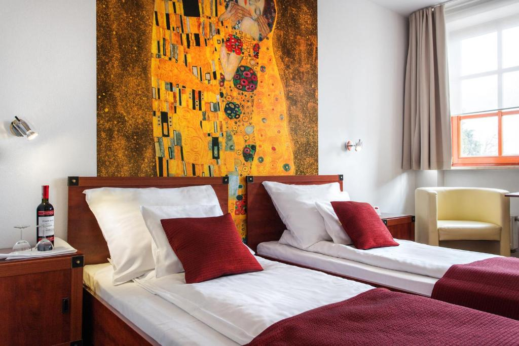 Lova arba lovos apgyvendinimo įstaigoje Hotel B.A.S. Villa Residence