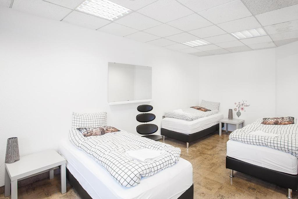 A bed or beds in a room at bgb - Guesthouse