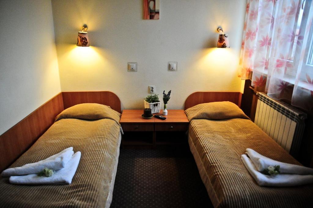 Krevet ili kreveti u jedinici u okviru objekta Ośrodek Usług Hotelarskich Kinga