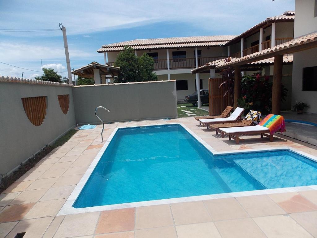 The swimming pool at or near Pousada Villas do Arraial