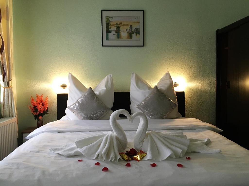 Ein Bett oder Betten in einem Zimmer der Unterkunft Asia Oase