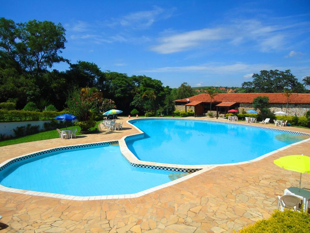 The swimming pool at or near Hotel Fazenda Pontal de Tiradentes