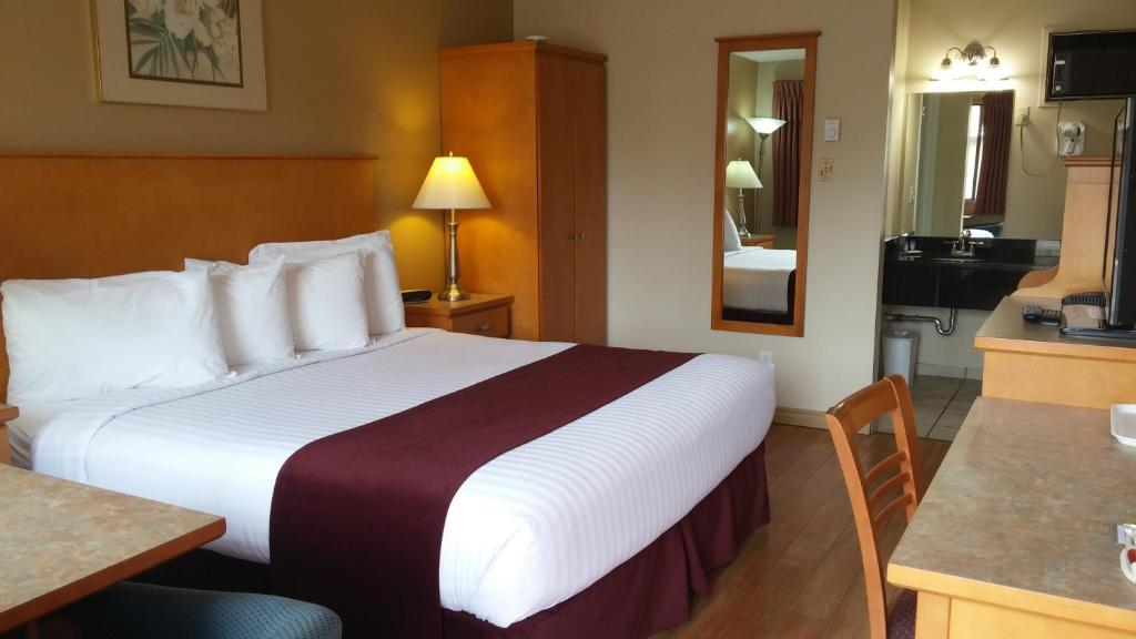 A bed or beds in a room at Canadas Best Value Inn & Suites-Vernon