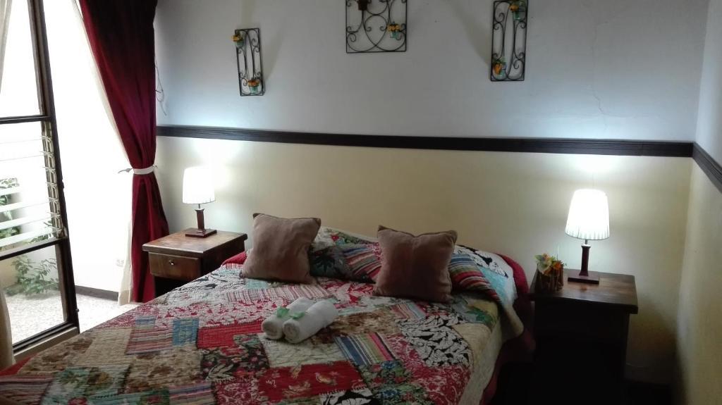 Cama o camas de una habitación en Hostel Cala