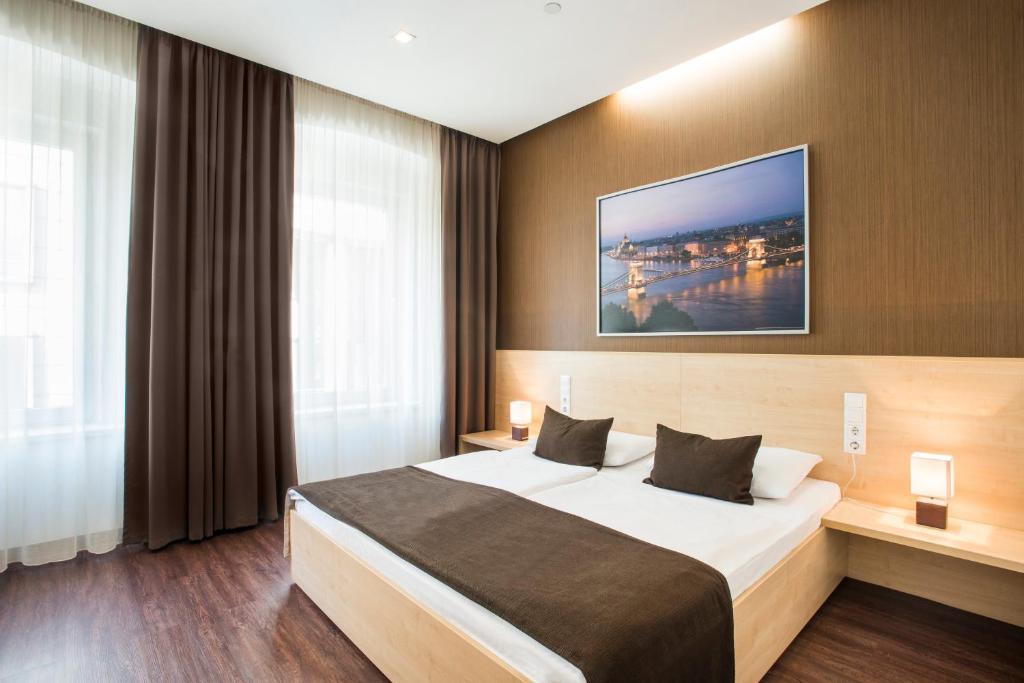 Letto o letti in una camera di Promenade City Hotel