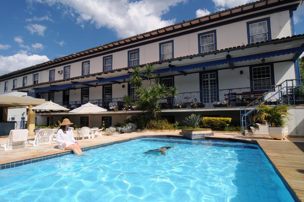 The swimming pool at or near Pousada do Garimpo
