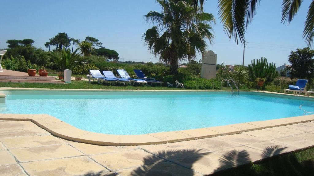 The swimming pool at or near Monte Novo da Longueira Turismo Rural