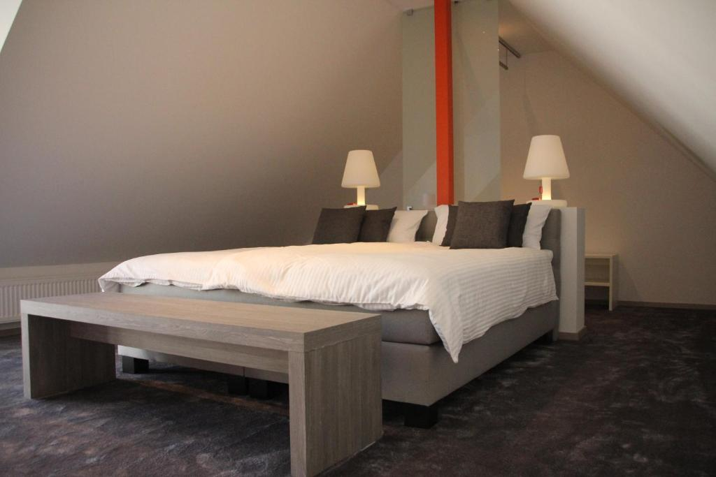 A bed or beds in a room at Boutique-Apart