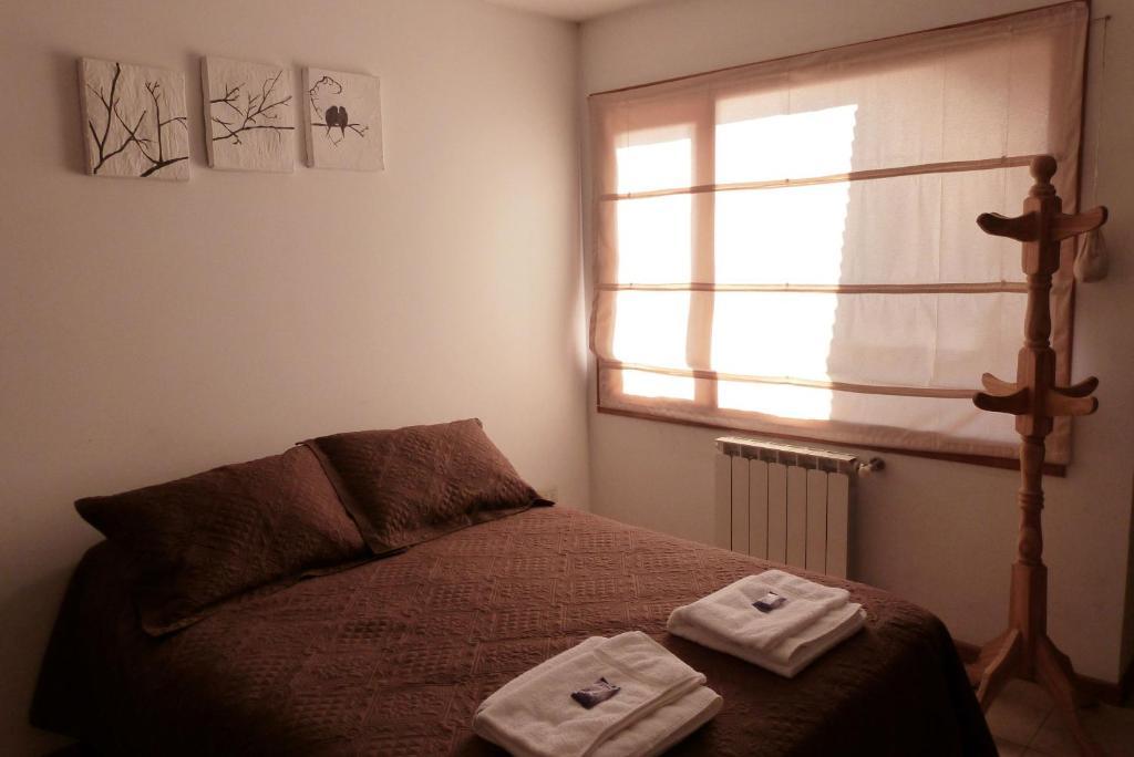 Una cama o camas en una habitación de Departamento Ramayon