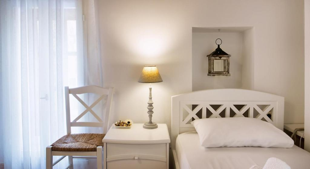 A bed or beds in a room at Ontas Traditional Hotel