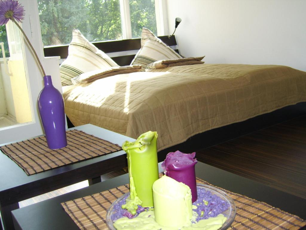 A bed or beds in a room at Nikol Apartments