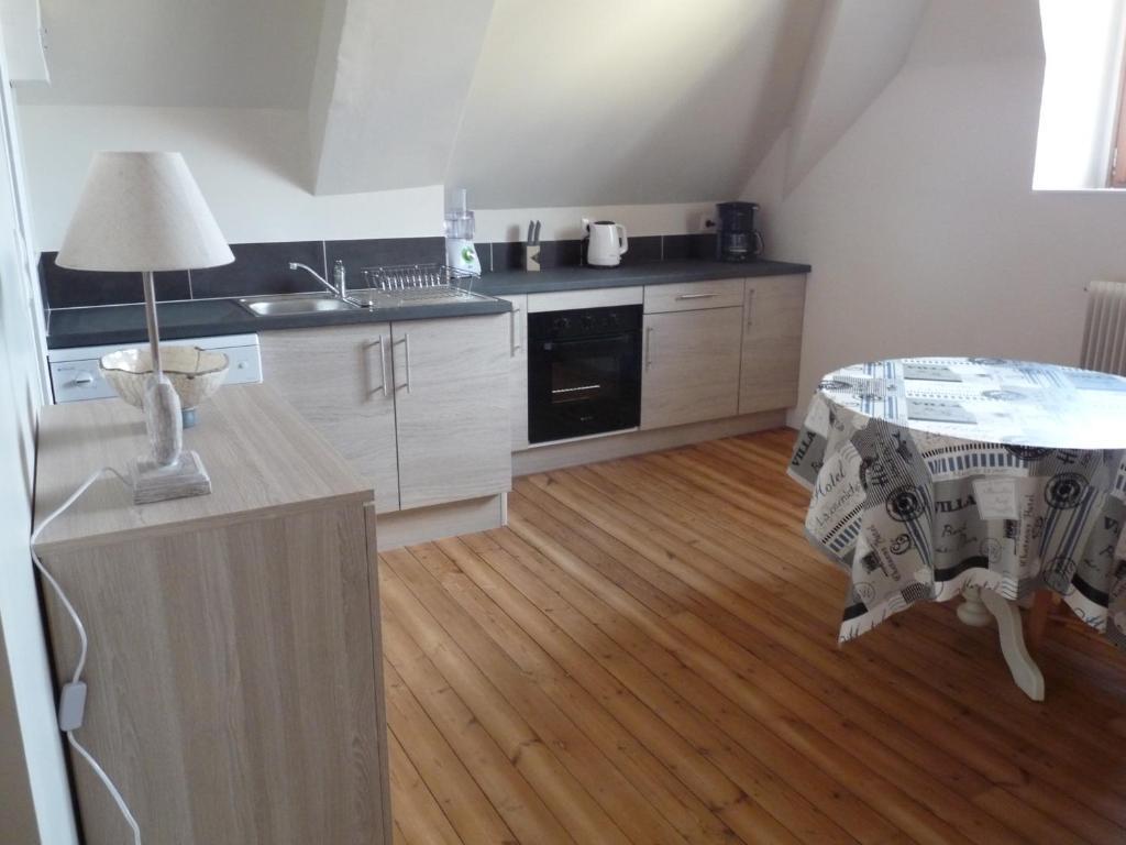 A kitchen or kitchenette at Le Gîte Du Potier