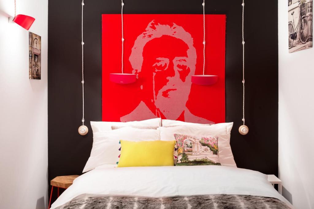 Cama ou camas em um quarto em Art Hotel Che