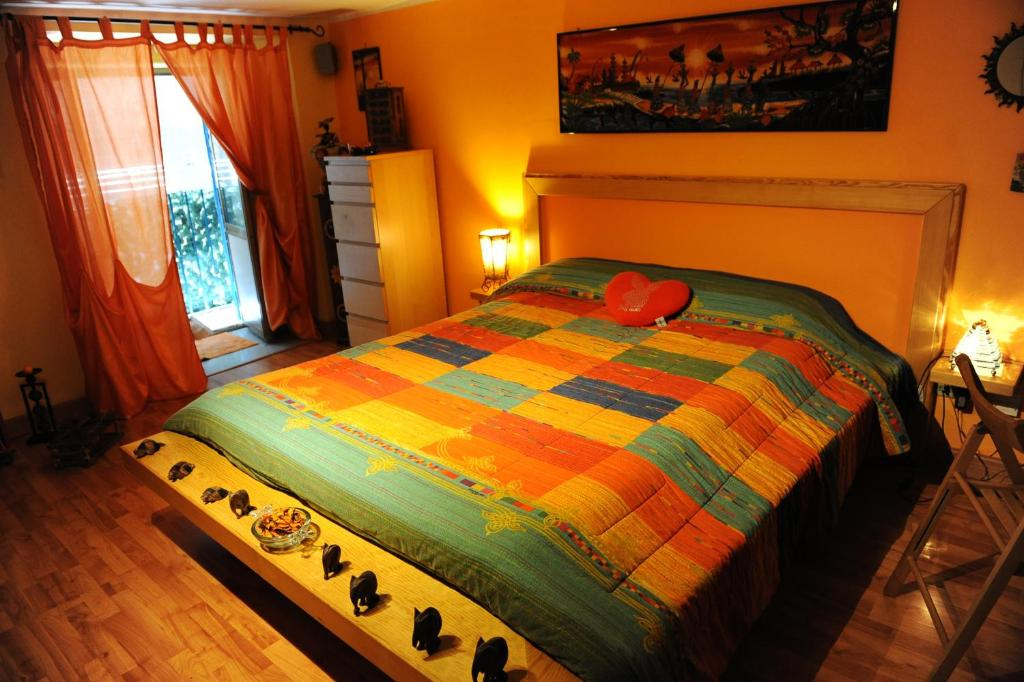 A bed or beds in a room at Orange House