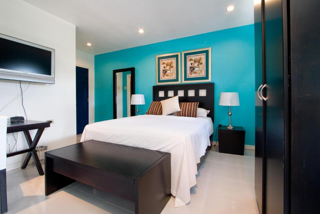 A bed or beds in a room at Hotel Normandie Limited
