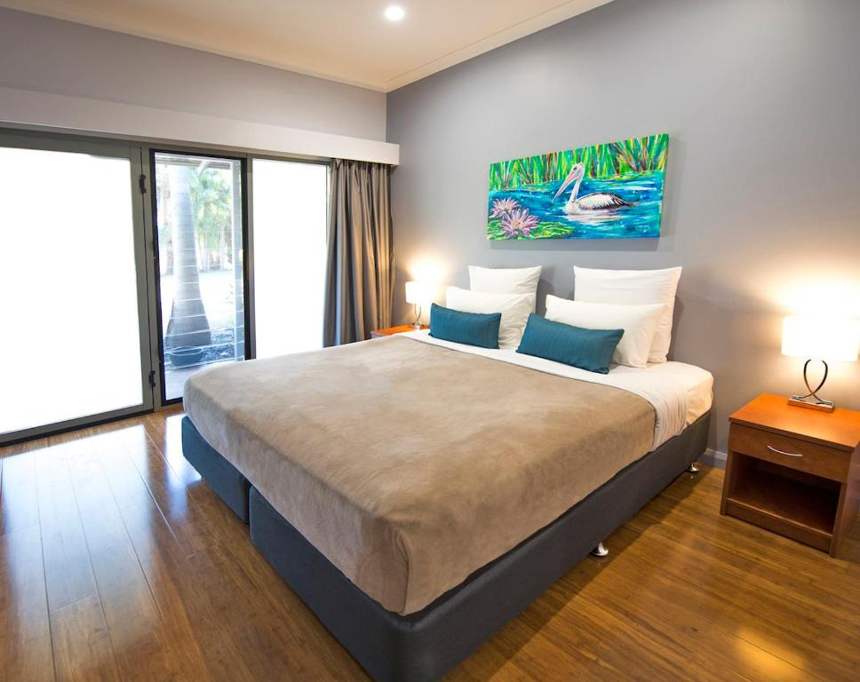 A bed or beds in a room at Kununurra Country Club Resort