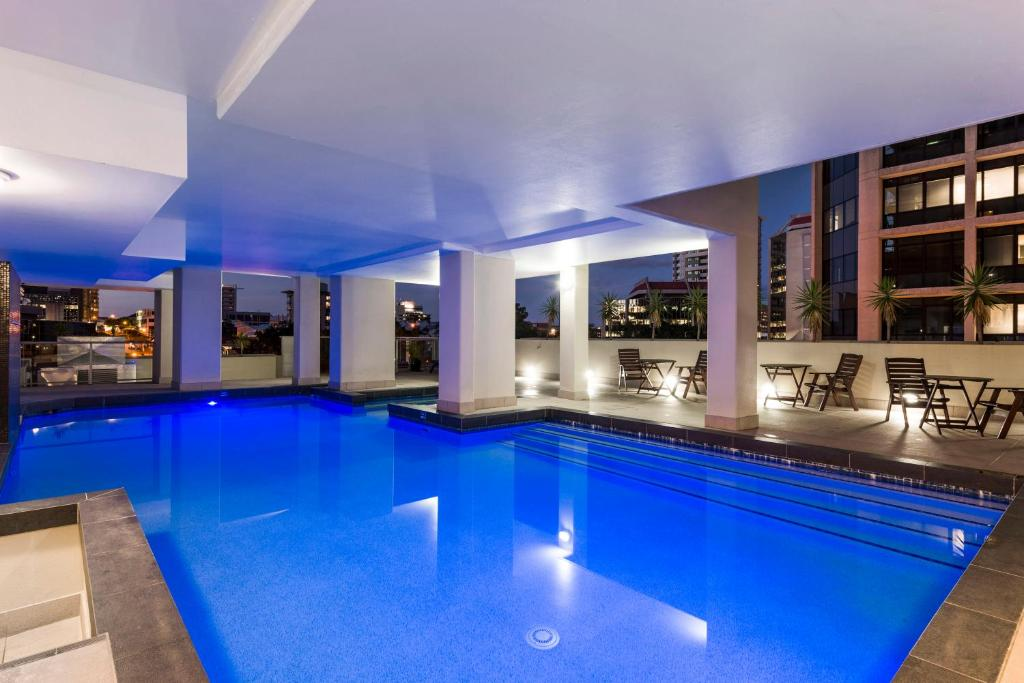 The swimming pool at or near Oaks Brisbane Lexicon Suites