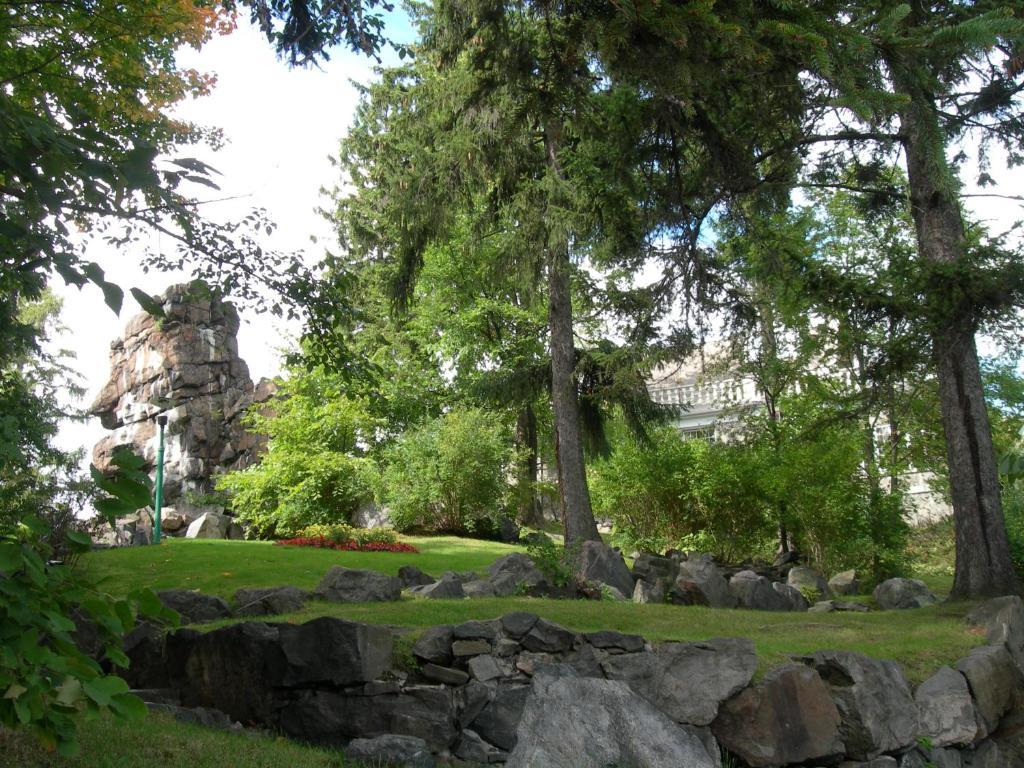 A garden outside Le Manoir du Rocher