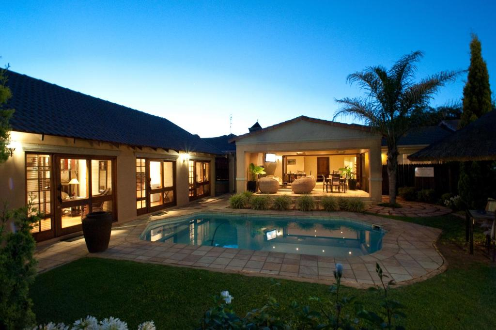 The swimming pool at or near Rise and Shine Lodge