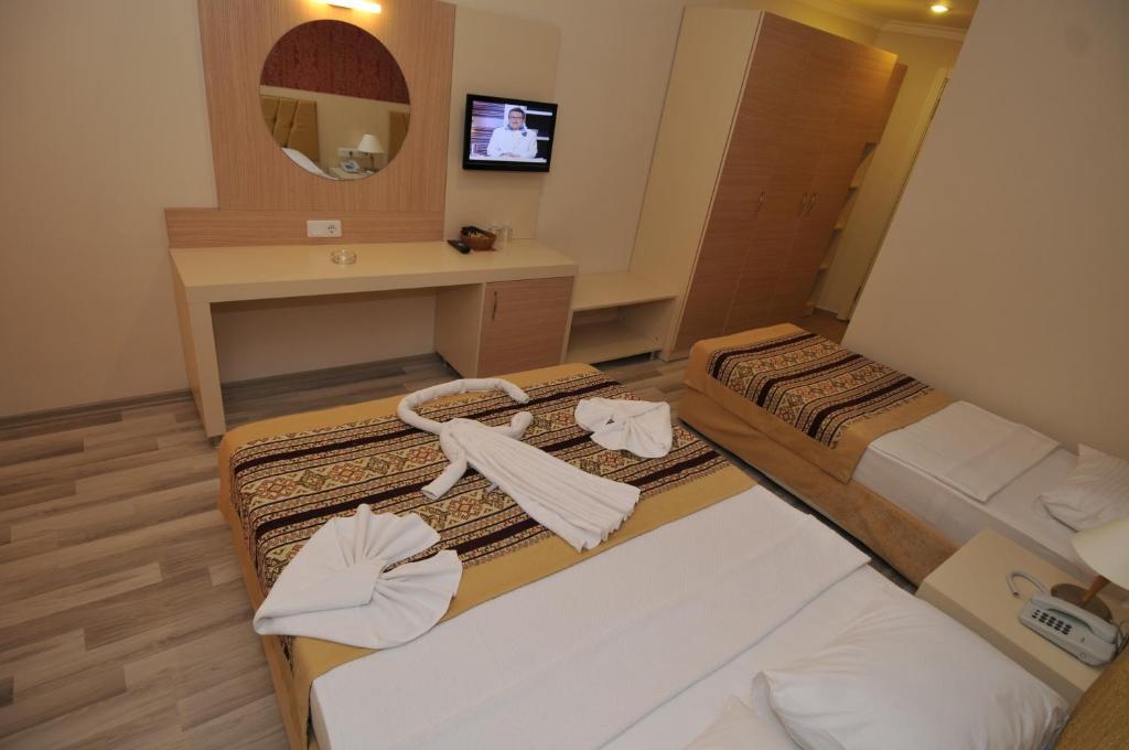 Кровать или кровати в номере Klas Hotel