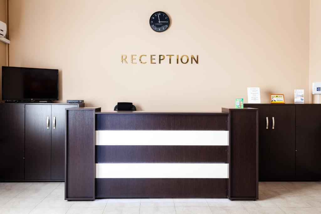 The lobby or reception area at Lexx Hotel