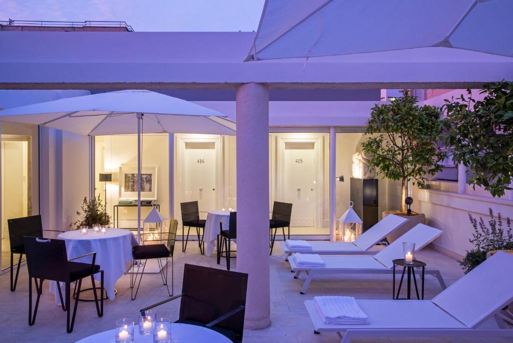 Restaurant ou autre lieu de restauration dans l'établissement White Villa Tel Aviv Hotel
