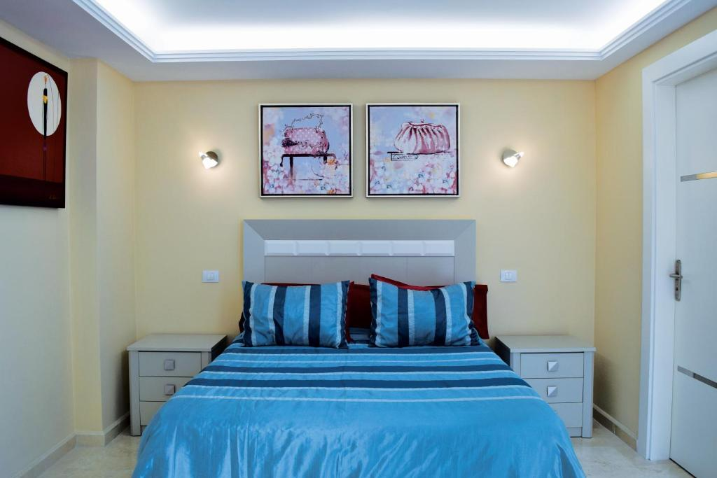 A bed or beds in a room at La Volpe Rossa B&B